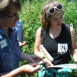 Sheila and Molly identifying a plant